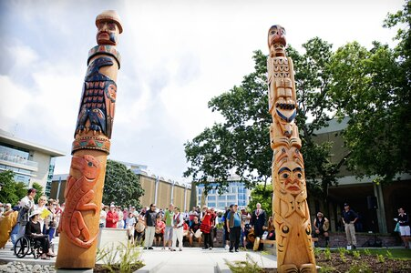"""""""Two Brothers"""" Spirit Poles in Spirit Square by  Butch Dick"""