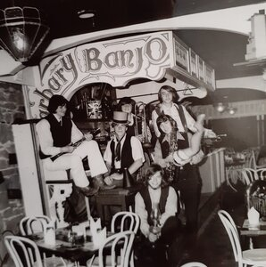 Photo- Shylock L to R Ken Williams, John Gnam in the top hat, Wayne Davis, Craig Anderson with the lamp, Russ Botten with the leg out of his sax and John Demers 1970 Credit Ken Williams  -   Barbary Banjo