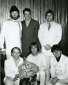 Photo- Mad Mel Potts (middle back row) with the Beach Boys in his exclusive clothing store located in Vancouver during the 1960\'s called \